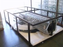 Picture of Hand Wrapping an Over Sized Pallet With Stretch Film